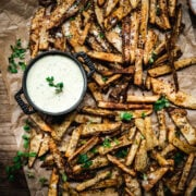 overhead view of crispy homemade fries on parchment paper