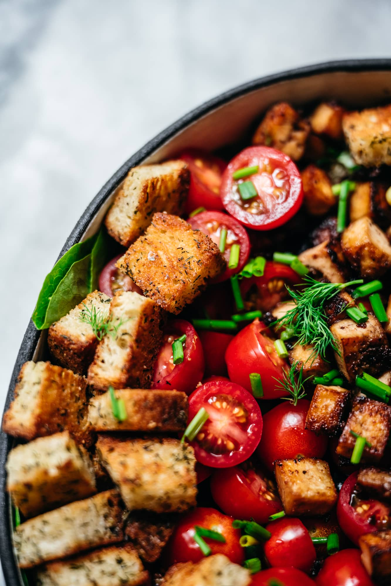 close up view of garlic dill croutons on a salad