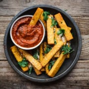 overhead view of polenta fries with marinara