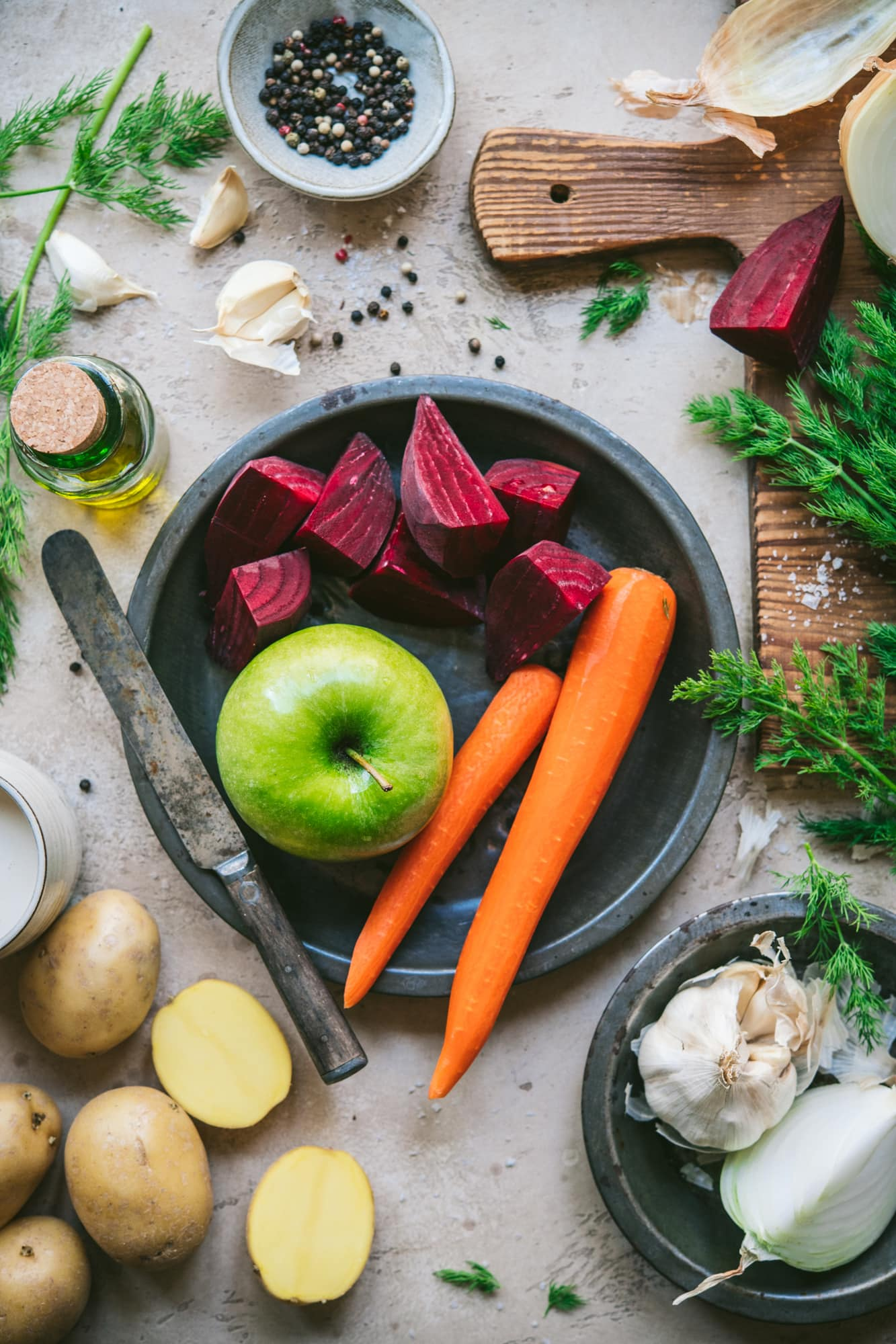 overhead view of ingredients for roasted beet, potato and carrot soup