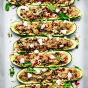 overhead view of quinoa stuffed zucchini boats in pan