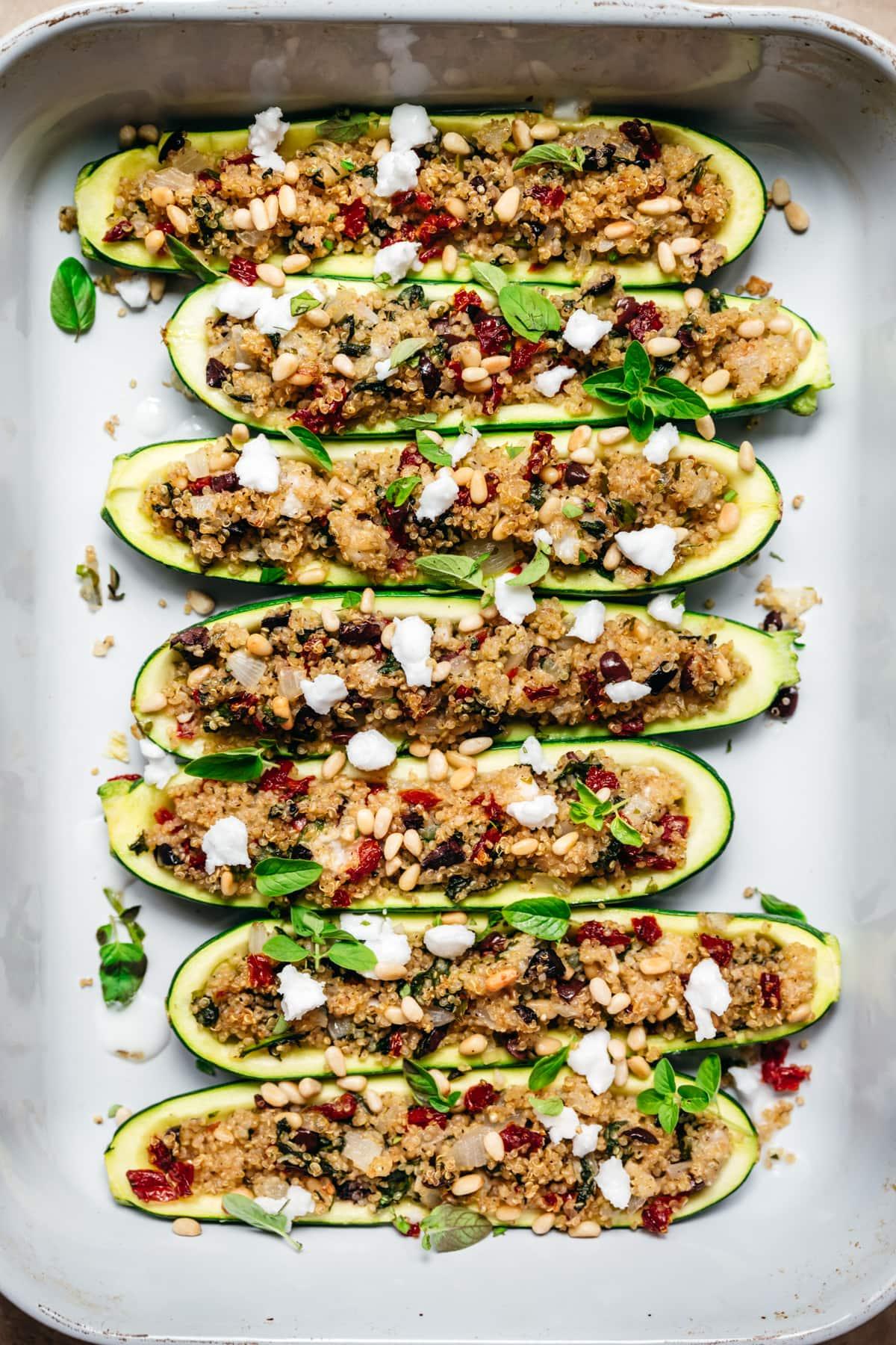 overhead view of vegan quinoa stuffed zucchini boats in pan