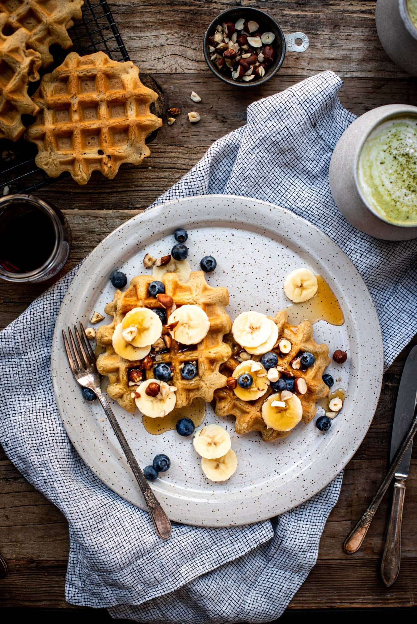 overhead view of waffles on plate with blueberries