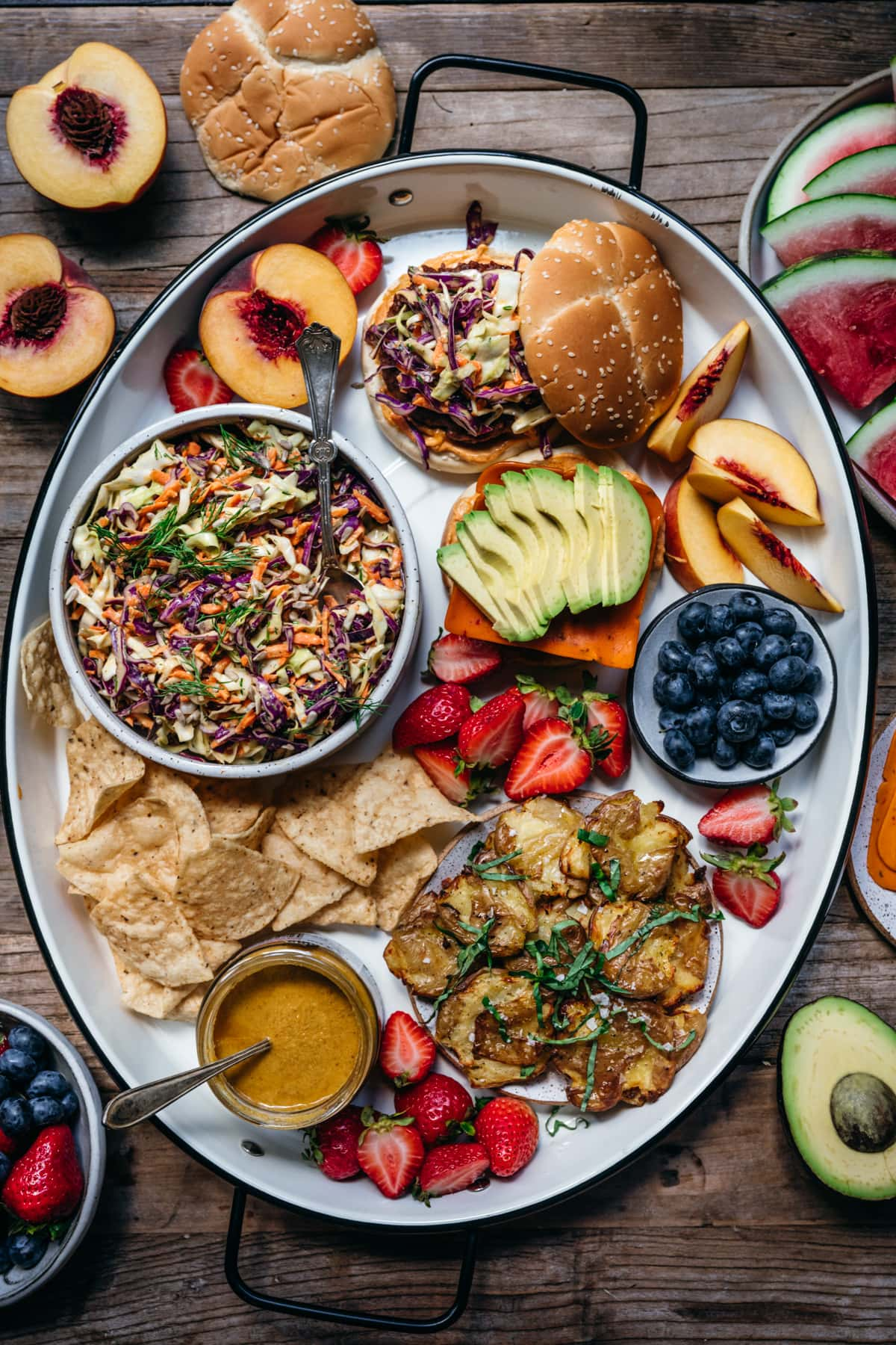 overhead view of large platter with vegan summer bbq food.