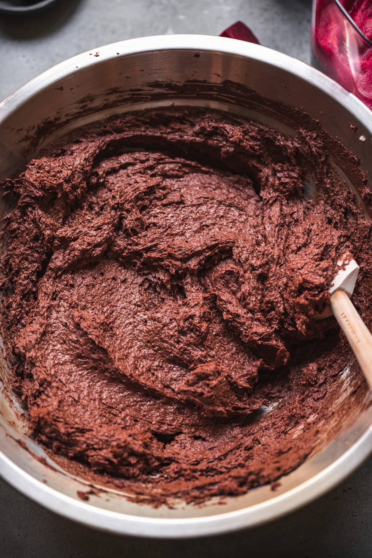 overhead view of beet brownie batter in a bowl.