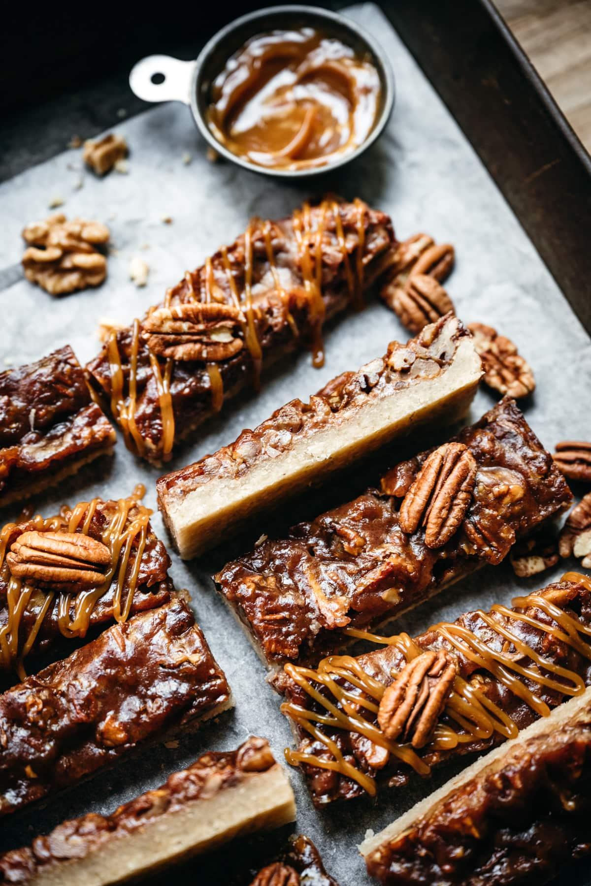side view of vegan maple bourbon pecan pie bars.