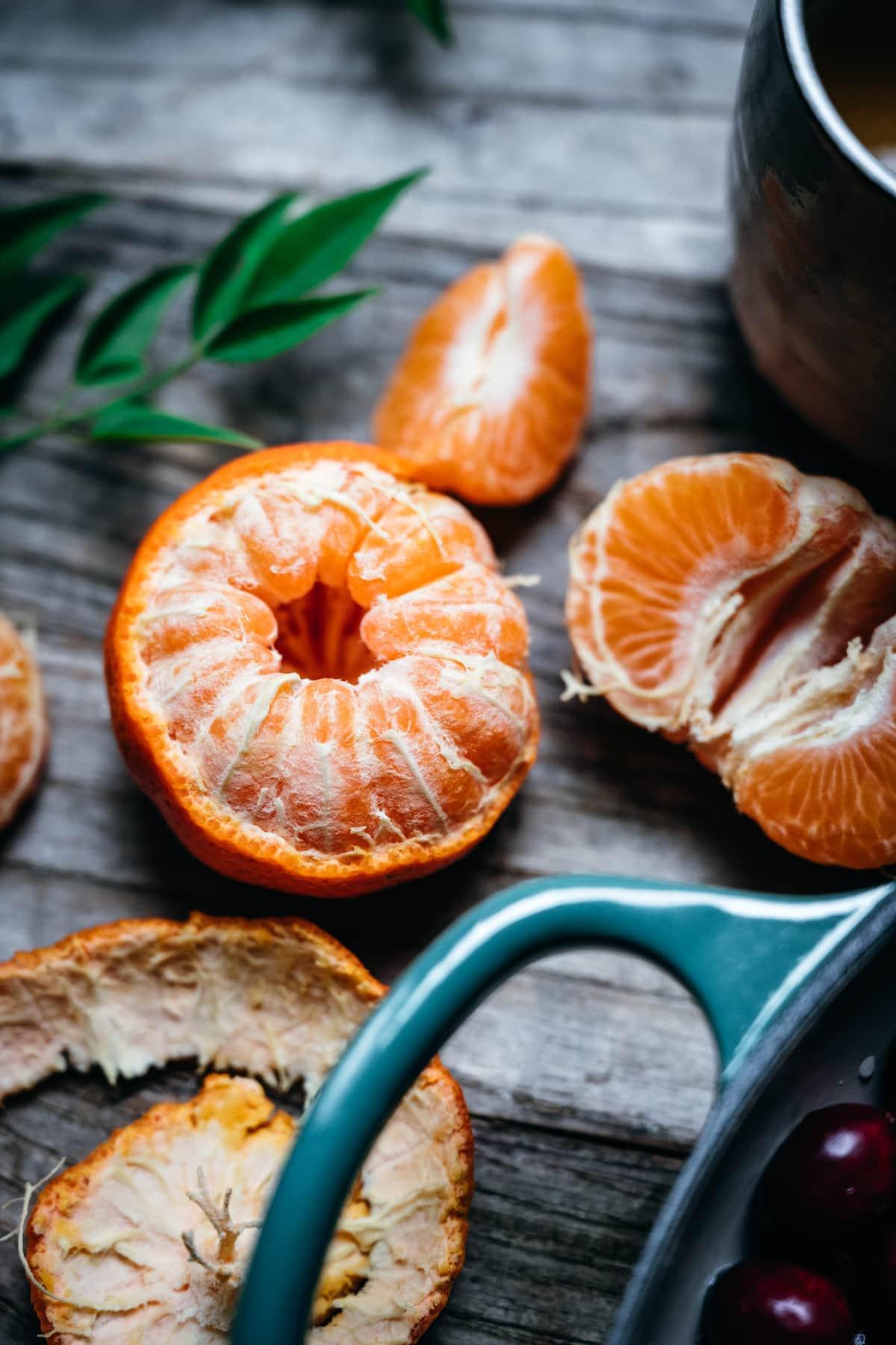 close up view of half peeled mandarin orange.