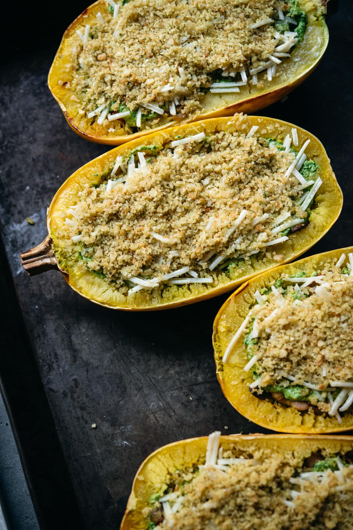 spaghetti squash topped with cheese and breadcrumbs.