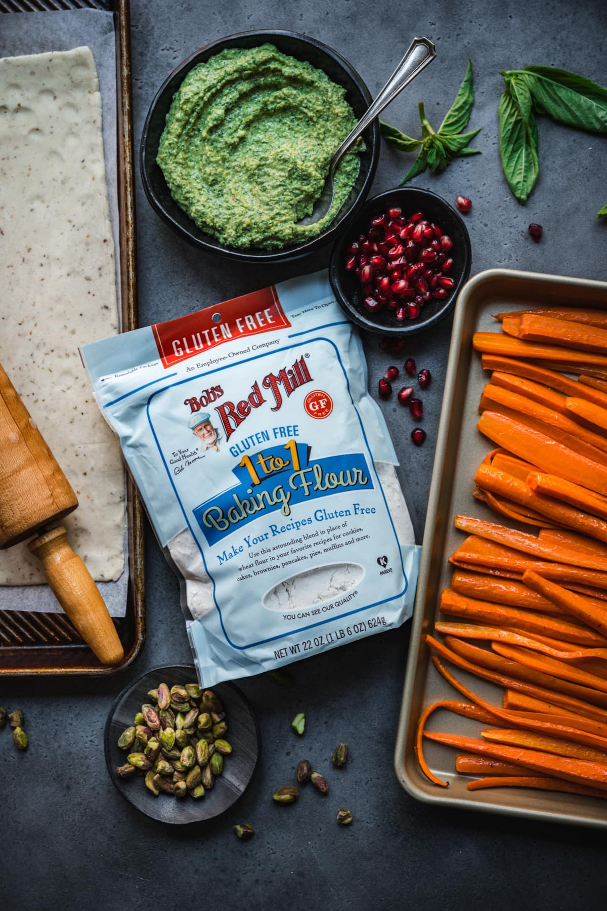 overhead view of ingredients for carrot pesto galette with Bob's Red Mill gluten free flour.