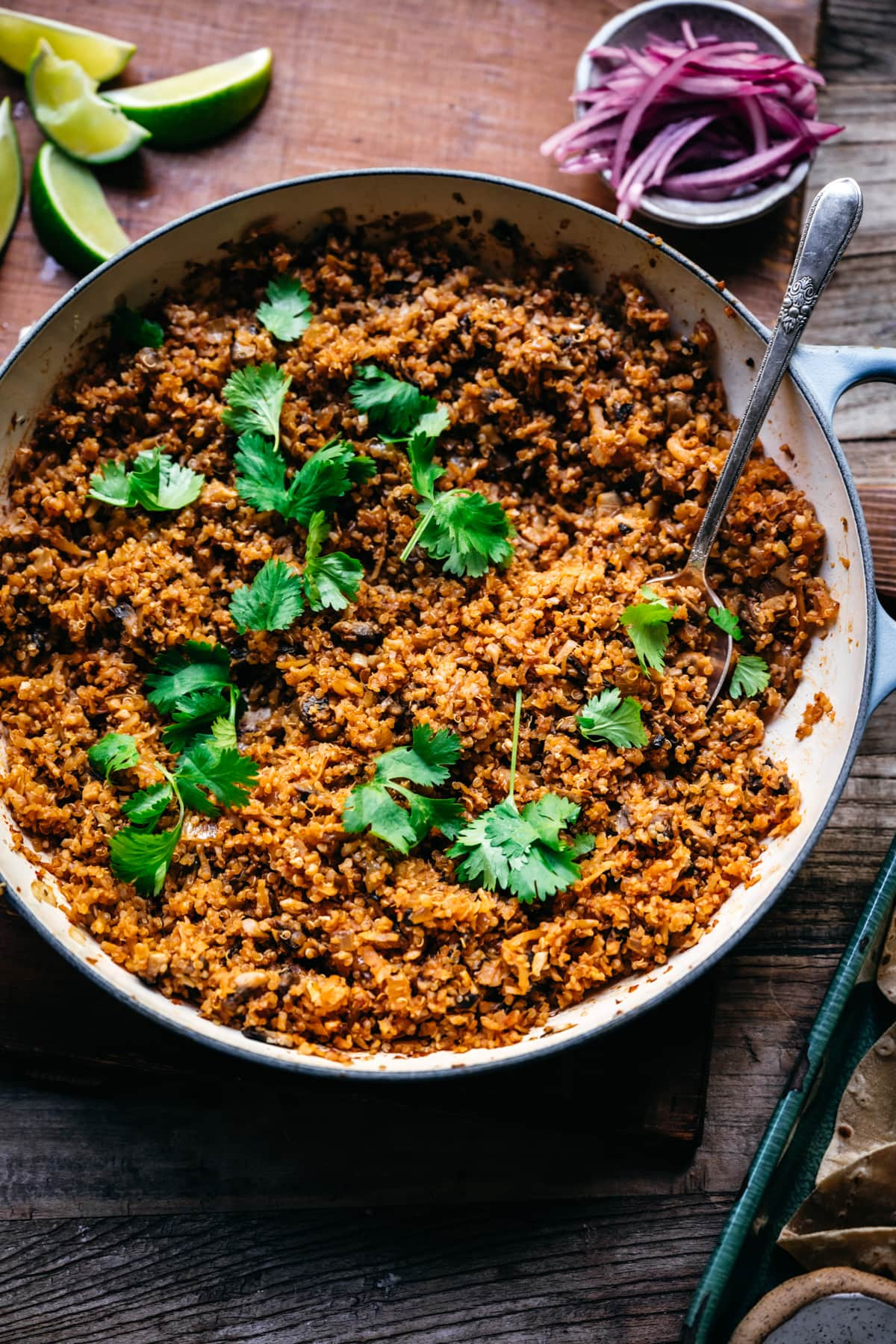 vegan taco meat in a large pan garnished with cilantro.