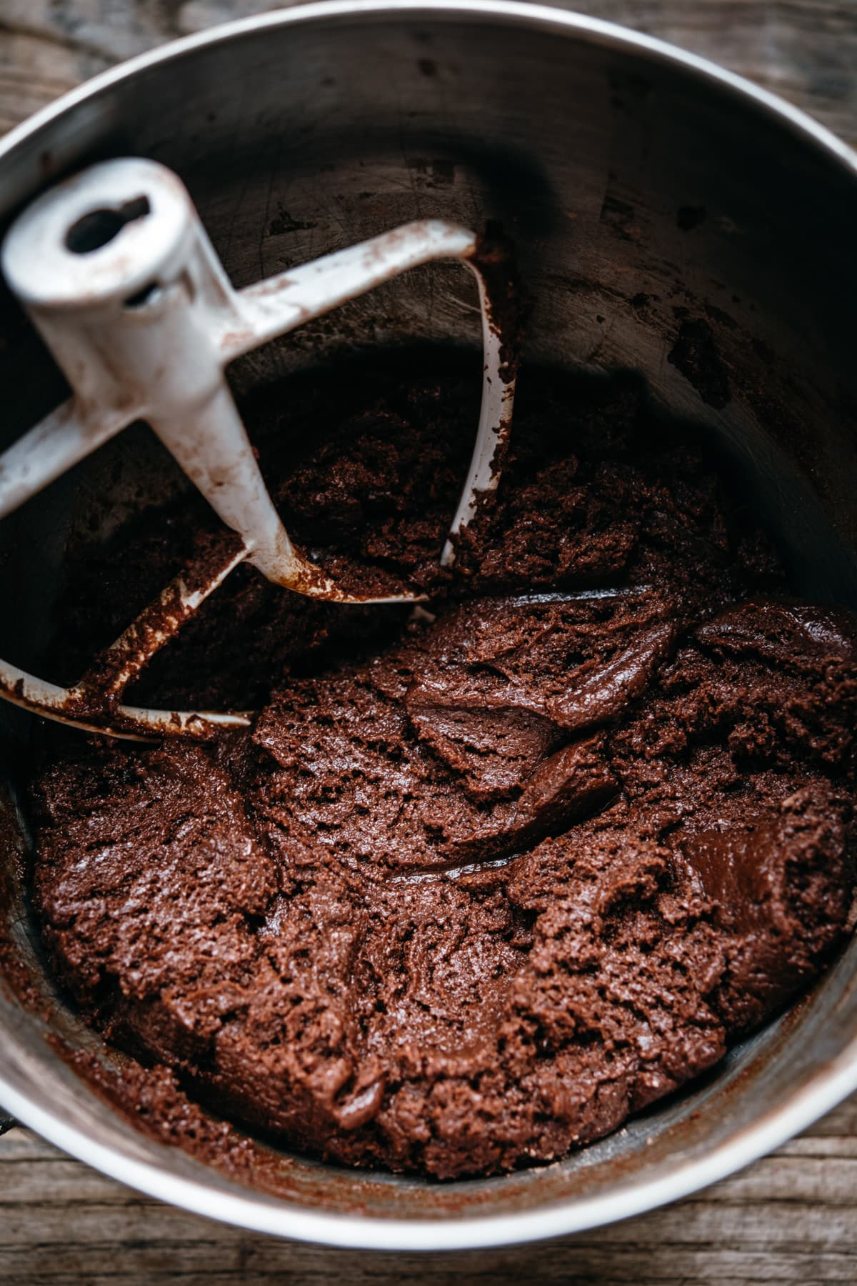 close up view of chocolate cookie dough in mixing bowl.