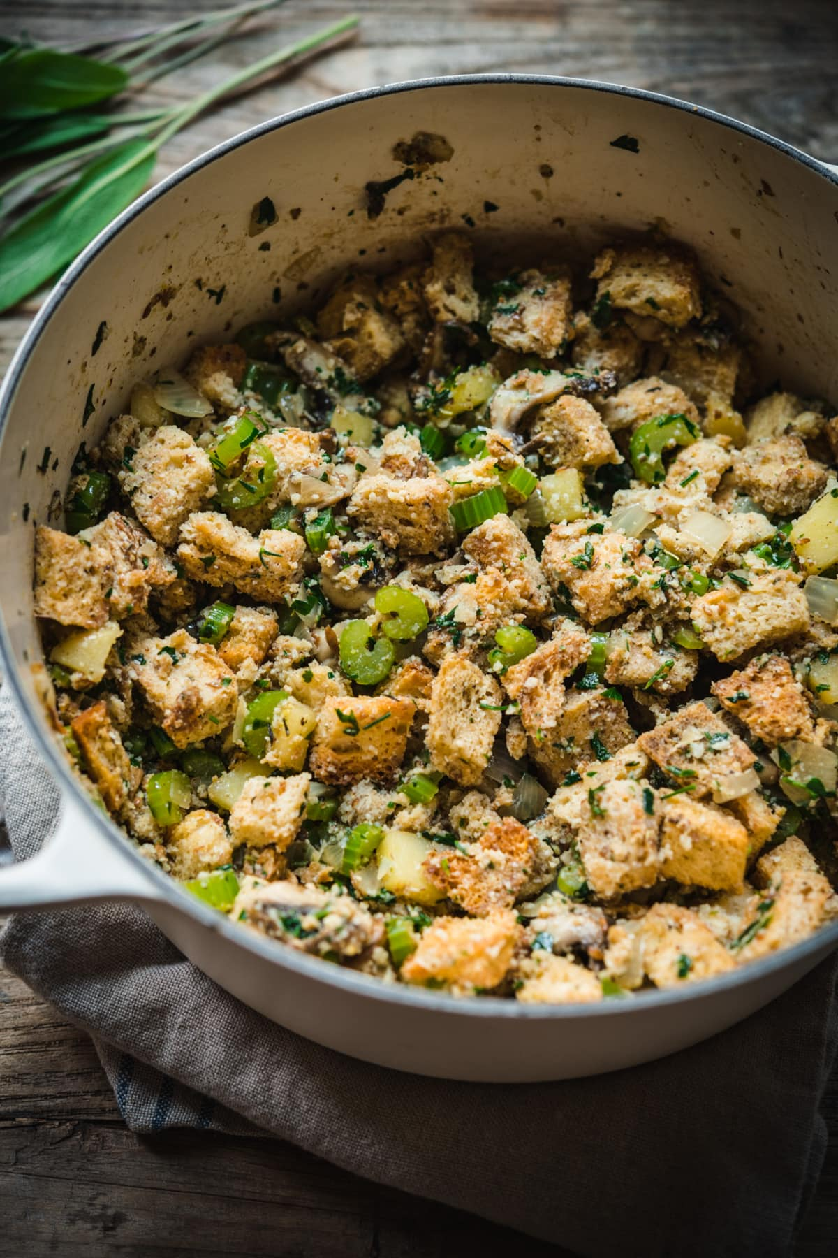 Stuffing ingredients in a pot before baking.