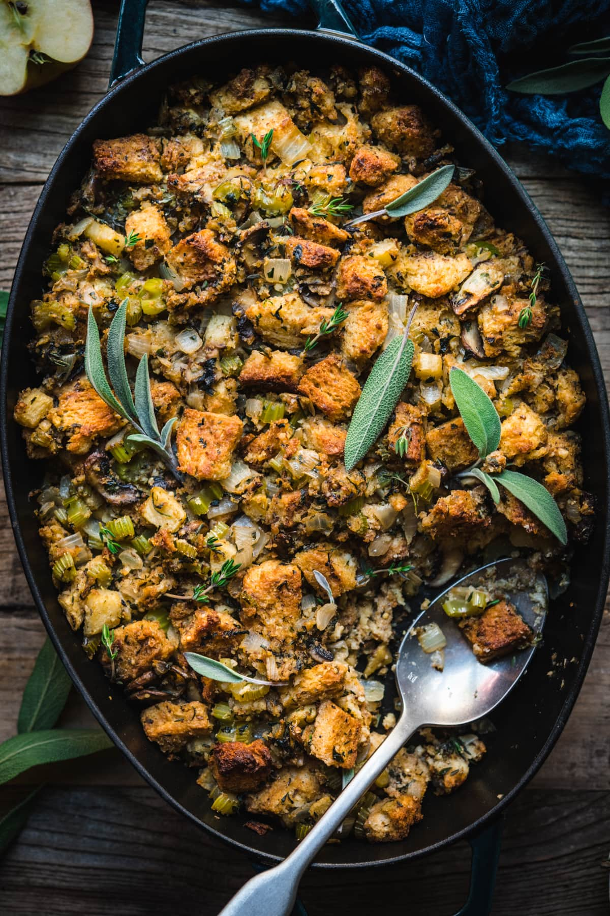 close up overhead view of gluten free vegan stuffing in a pan with fresh sage on top.