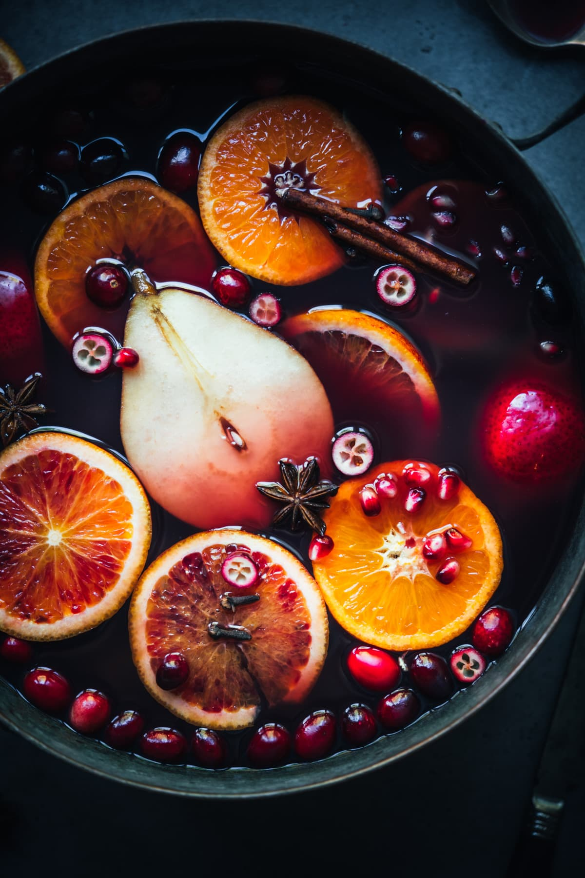 close up view of mulled wine in a large pot.