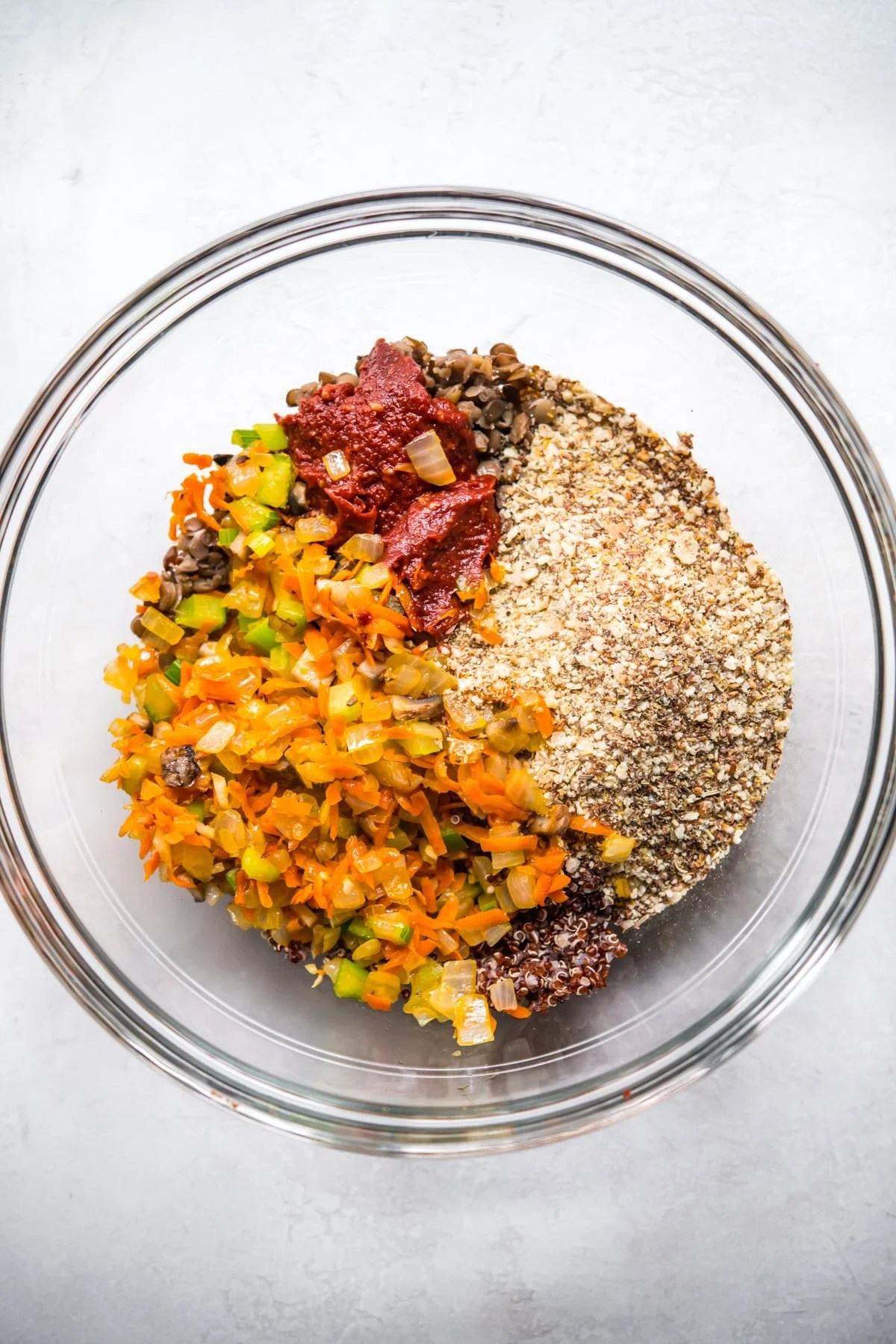 Glass bowl with ingredients for vegan meatloaf, unmixed.