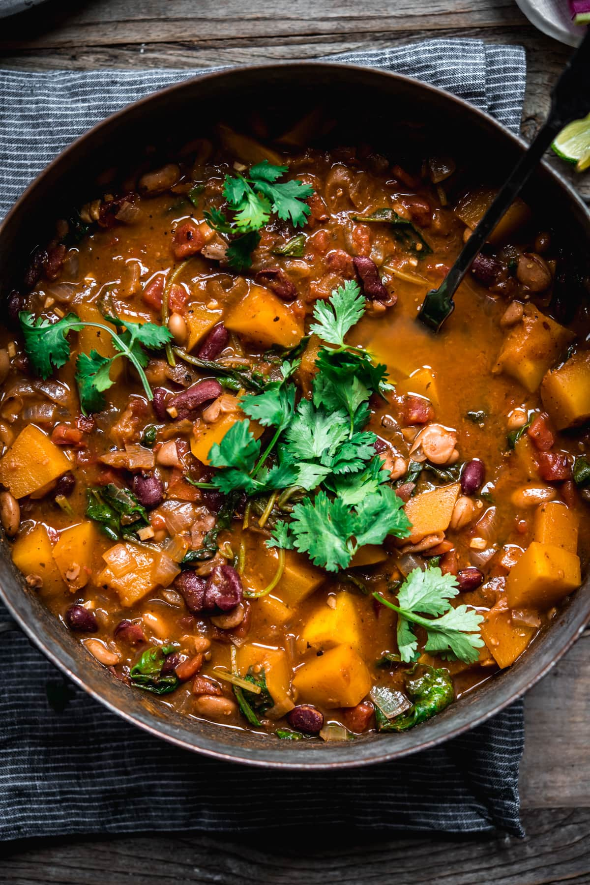 overhead view of vegan pumpkin and bean chili in a large pot.
