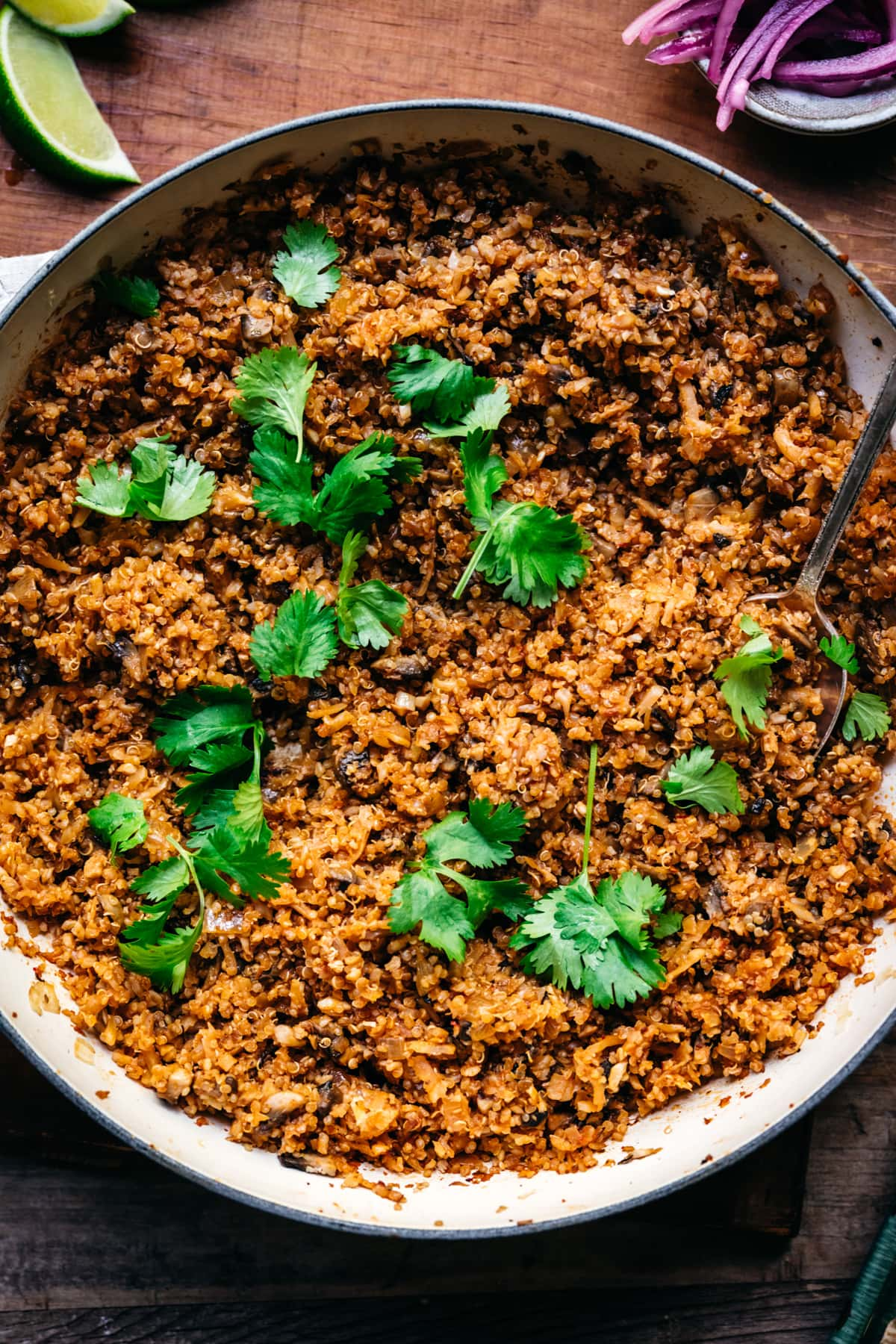 overhead view of vegan taco meat in a large pan garnished with cilantro.