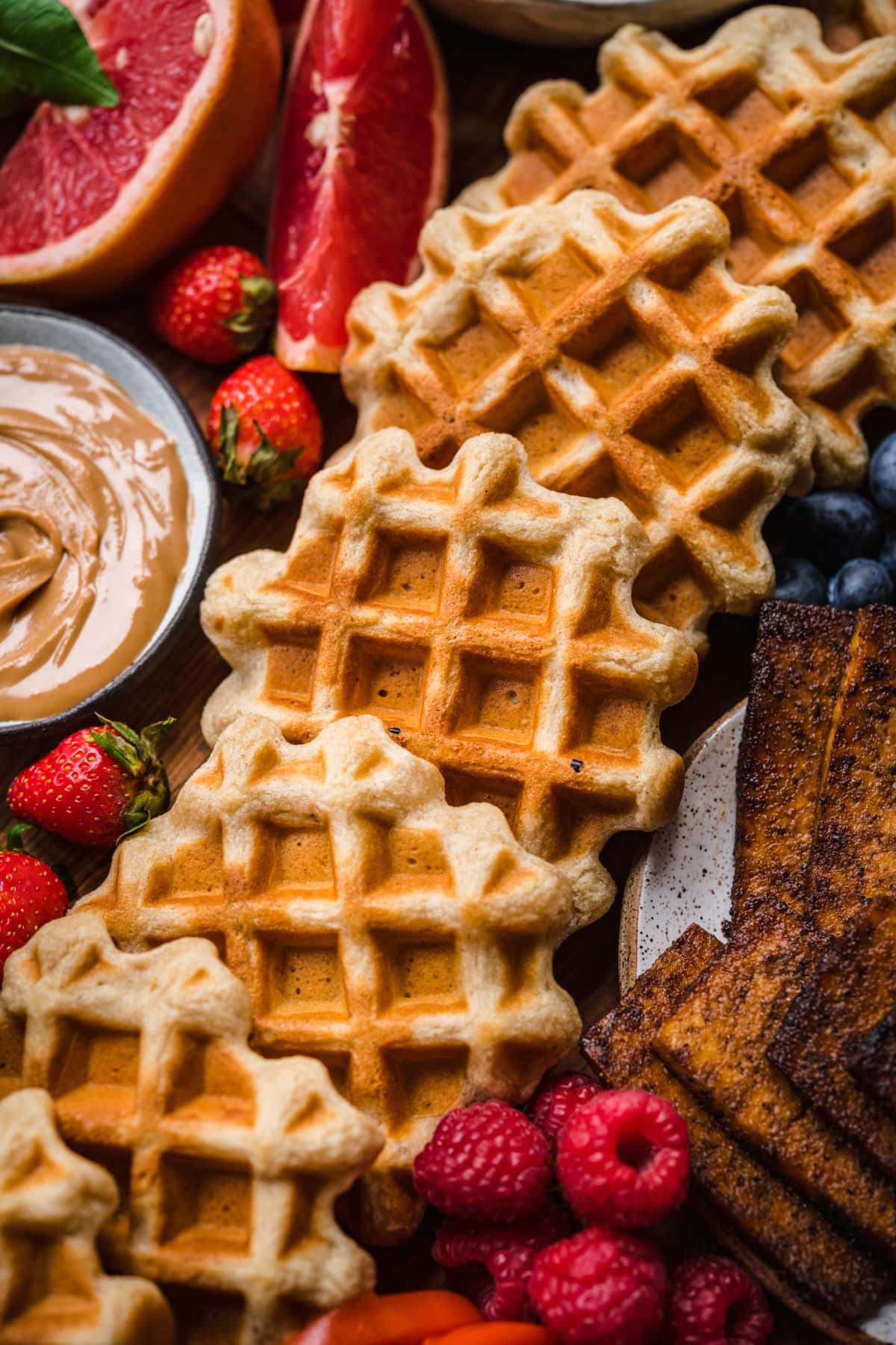 close up view of waffles on waffle board.