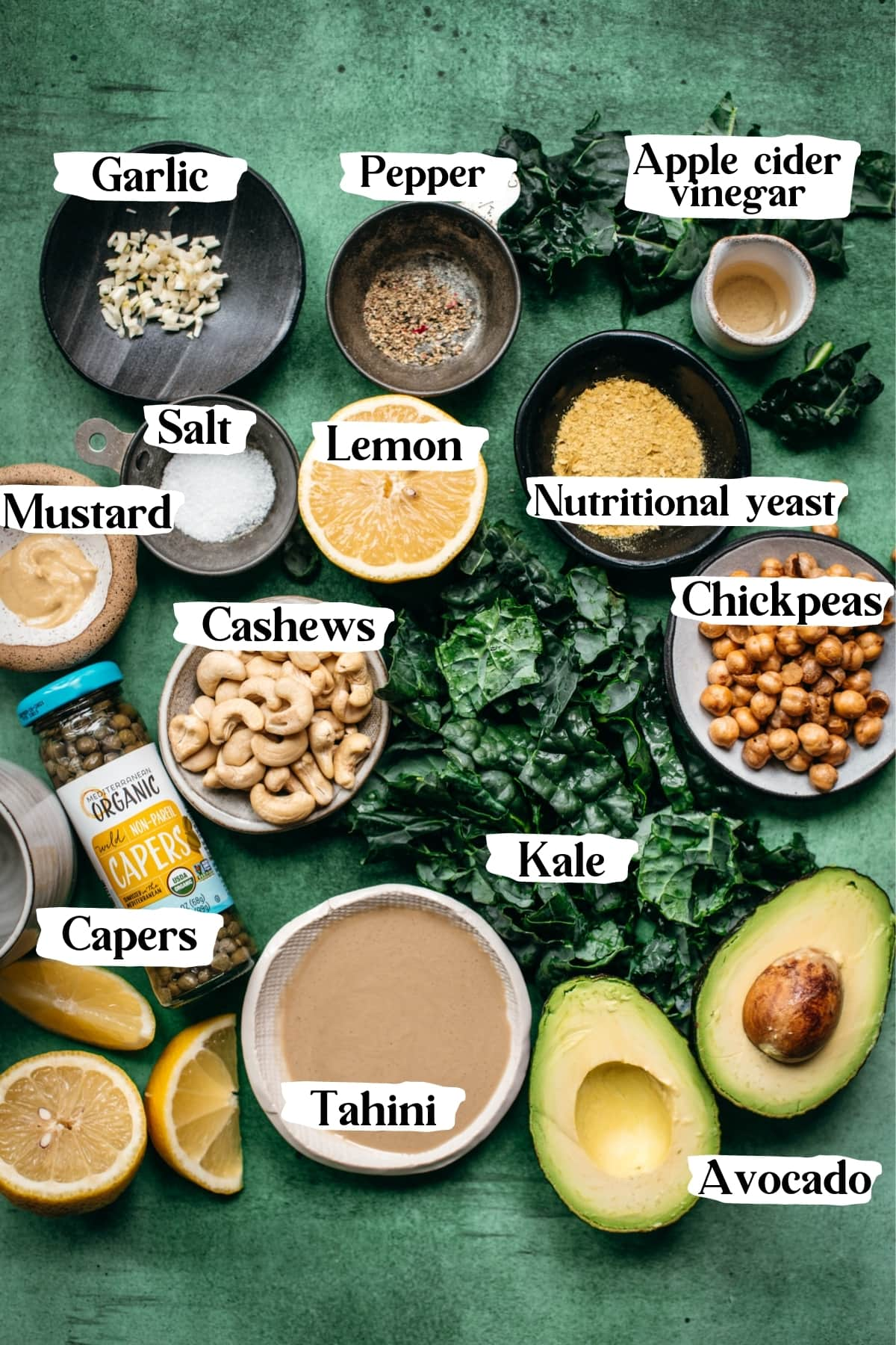 overhead view of ingredients for vegan kale caesar salad with text labels.