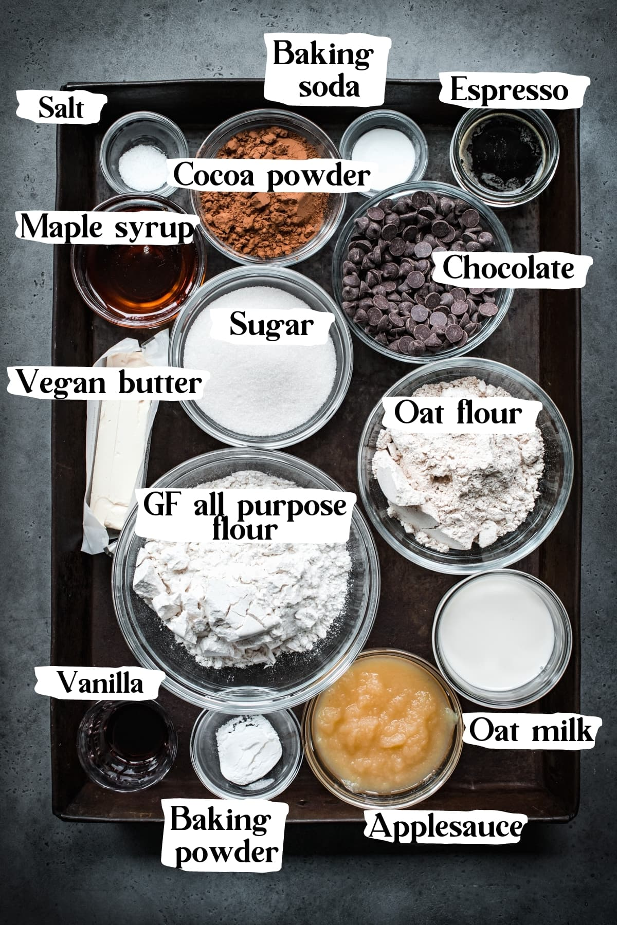 overhead view of ingredients for vegan chocolate cake with text labels.
