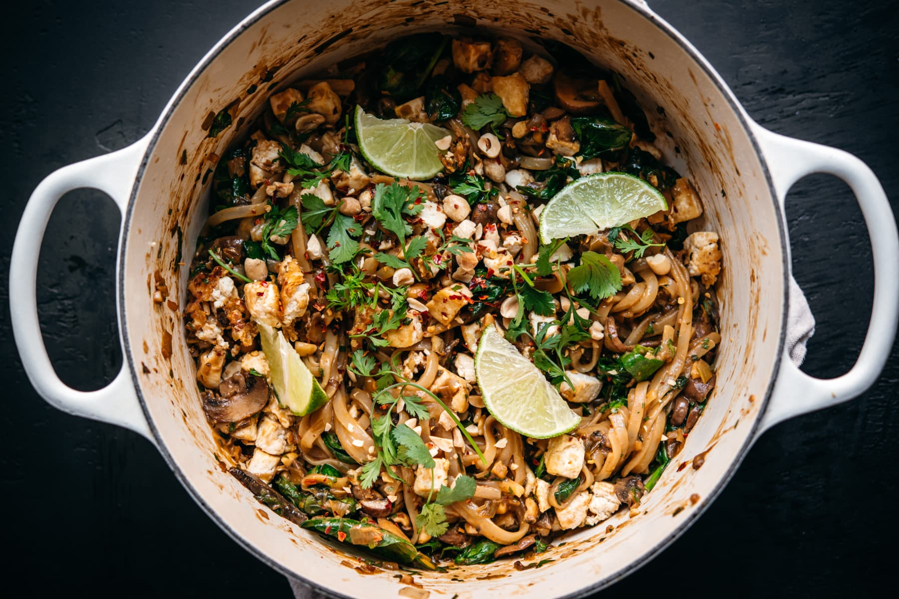 overhead view of vegan pad thai in a large white pot.