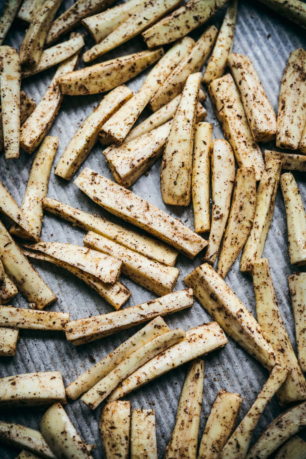 za'atar spiced parsnips on sheet pan before roasting.