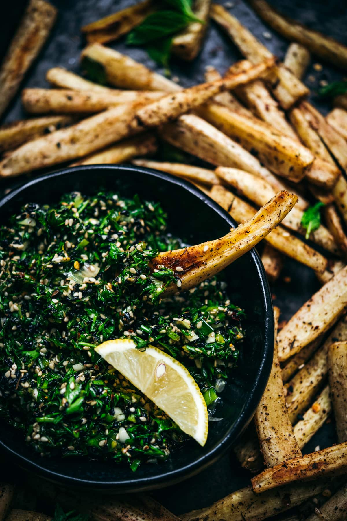 close up view of za'atar roasted parsnips.