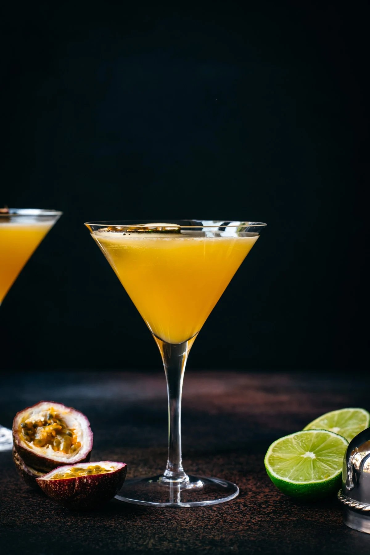 side view of passion fruit martini in a glass.