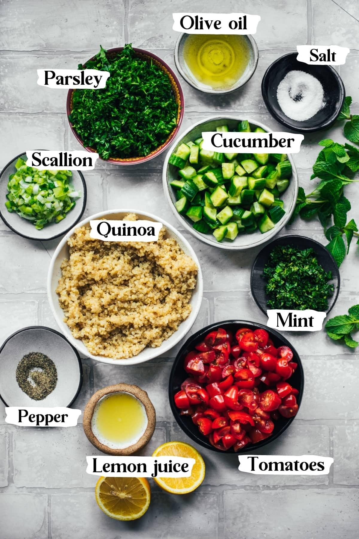 overhead view of ingredients for quinoa tabbouleh salad in small bowls.