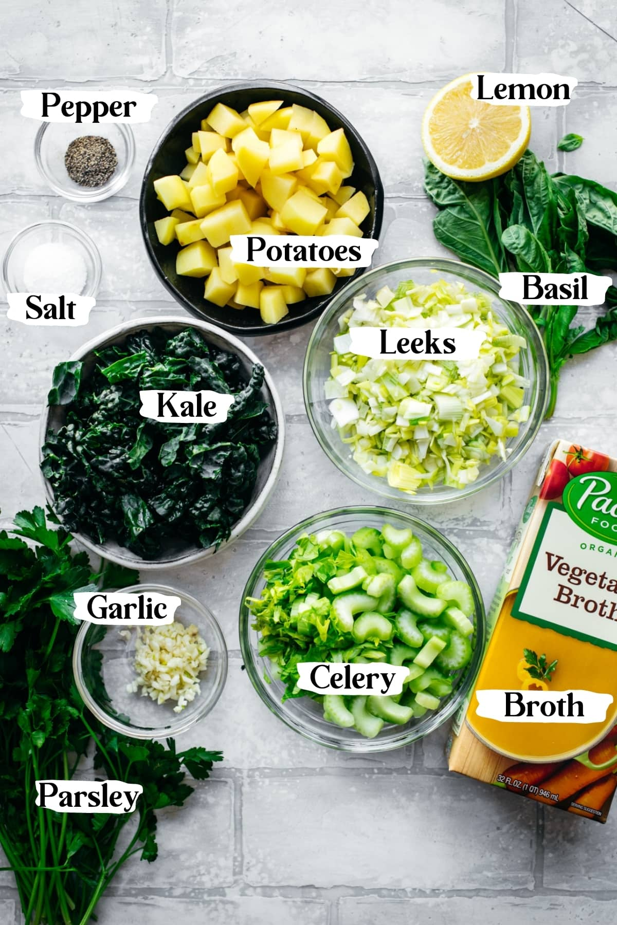 overhead view of ingredients for vegan potato kale soup.