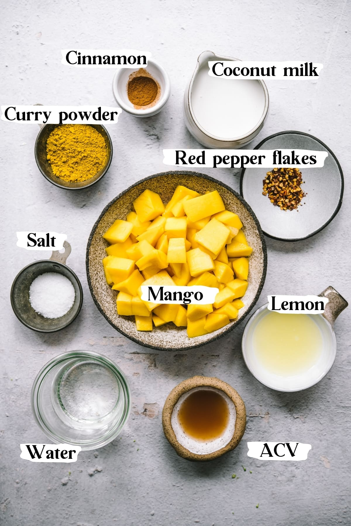 overhead view of ingredients for mango curry sauce.