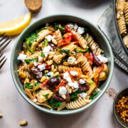 overhead view of vegan greek pasta in a large skillet.