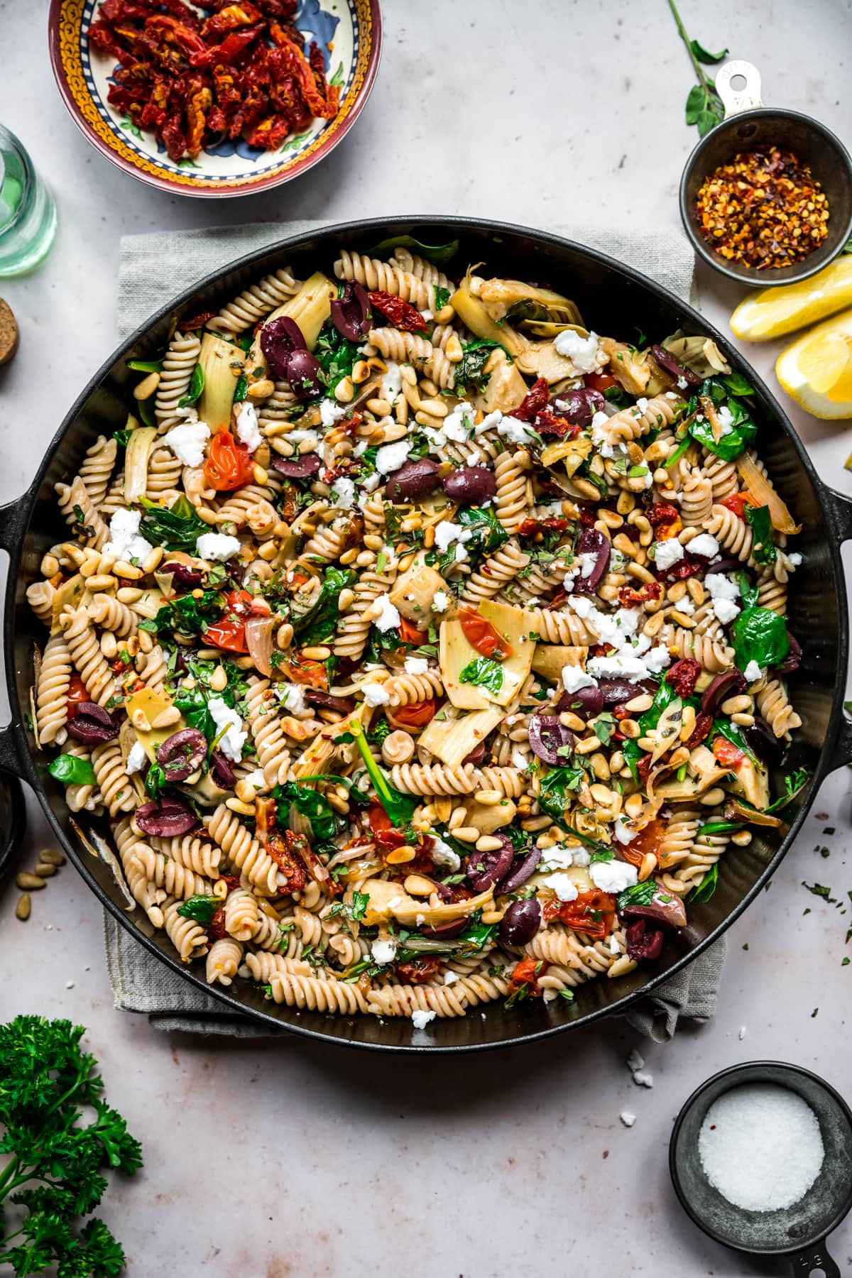 overhead view of vegan greek pasta in a large skillet.