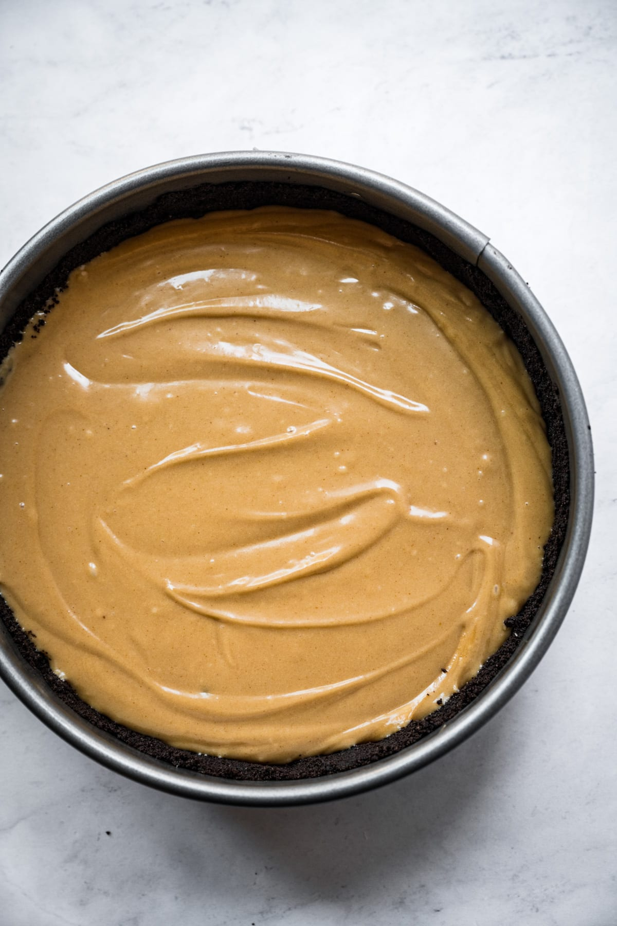 vegan peanut butter pie filling in chocolate cookie crust before chilling.