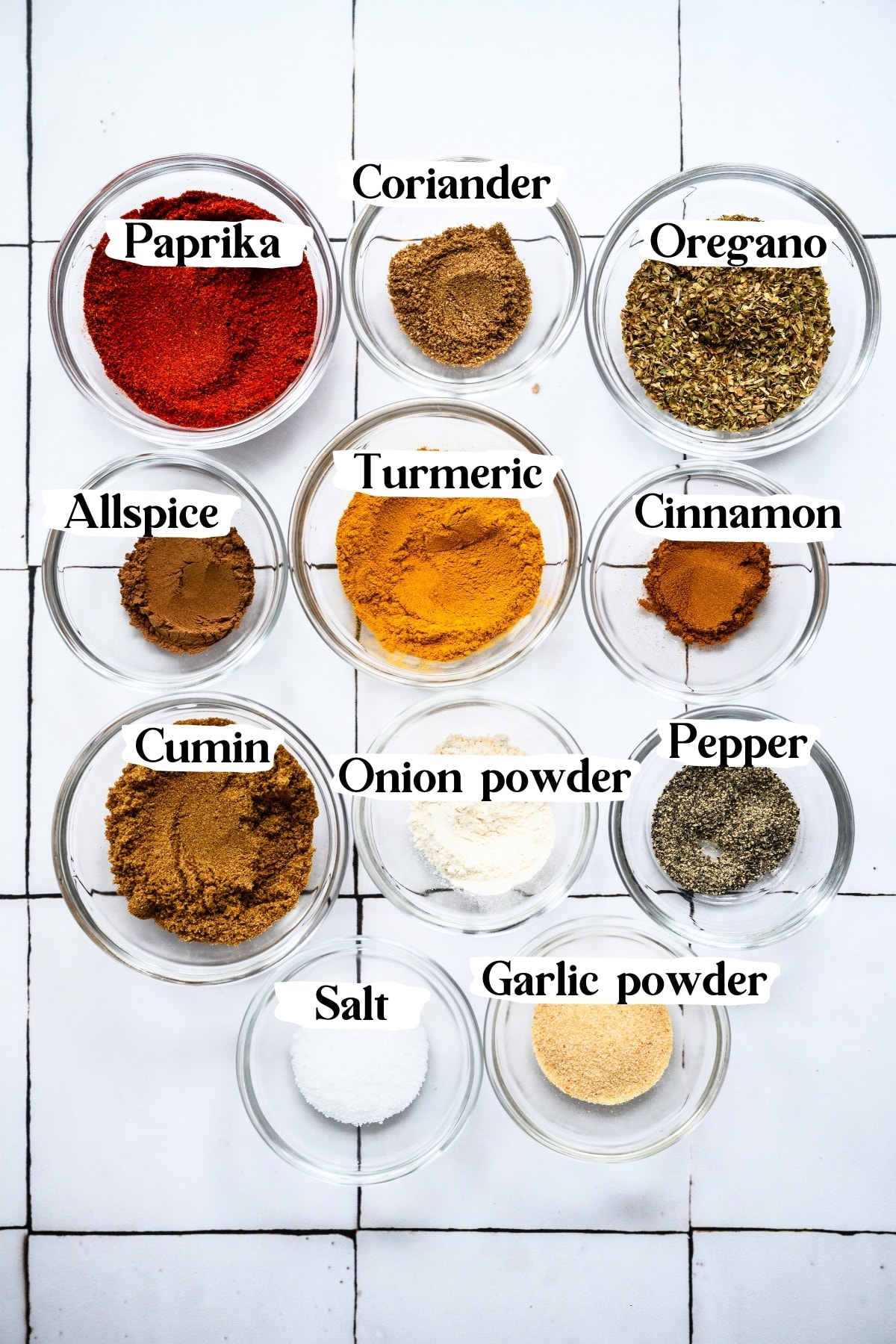 overhead view of spices in small bowls for shawarma spice blend.