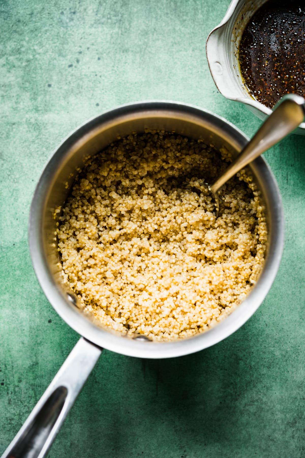 overhead view of cooked quinoa in a small pot.