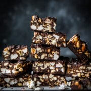 stack of salted caramel popcorn chocolate bars sliced into squares.