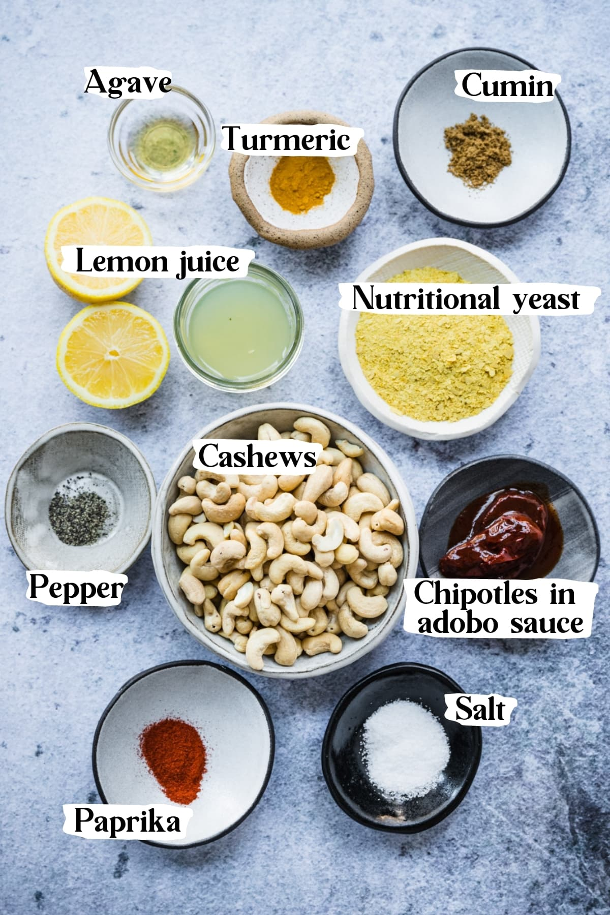 overhead view of ingredients for vegan queso dip in small bowls.