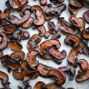 close up view of mushroom bacon on a sheet pan.