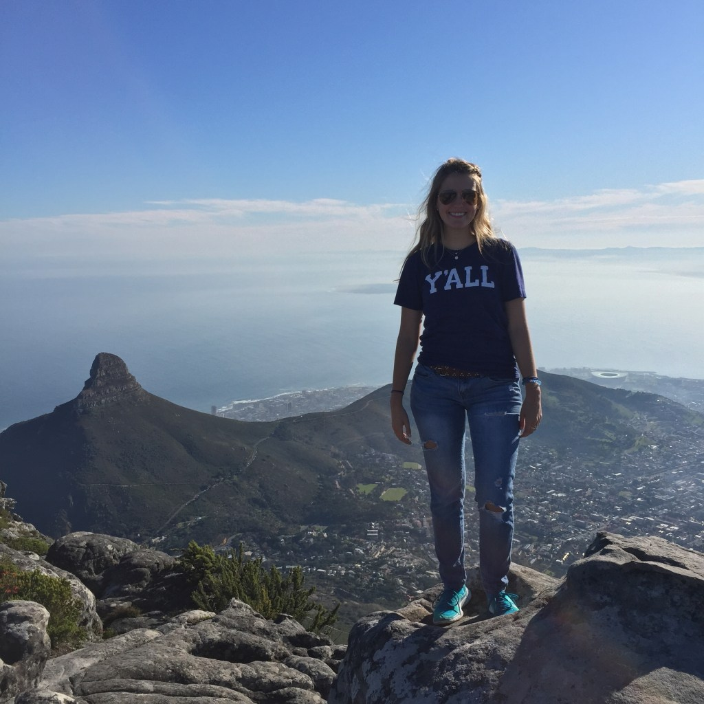 Heather on top of Table Mountain with view of Lion's Head