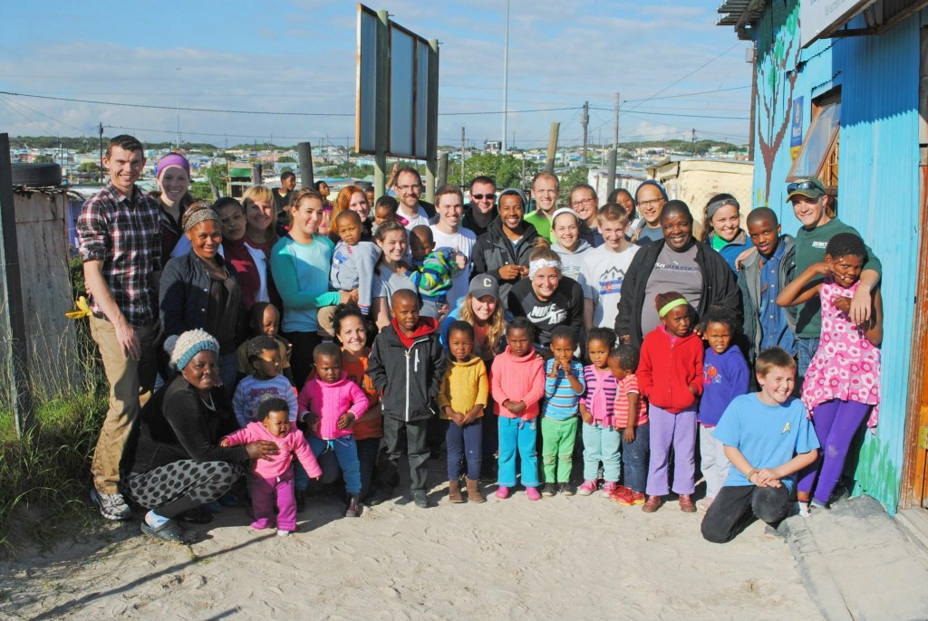 Cru team in Khayelitsha with Pastor Peter and the children of his church's Educare center