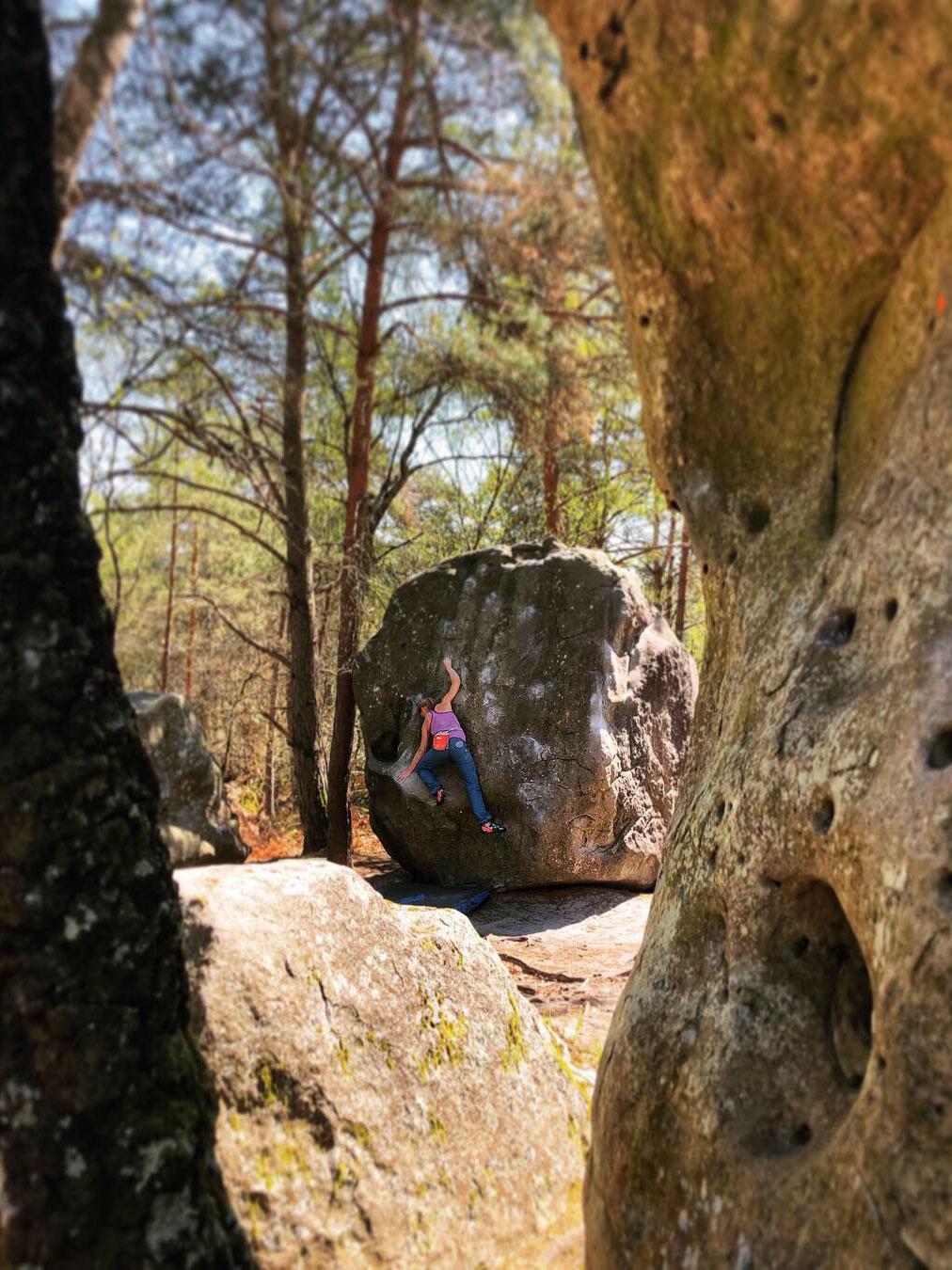 Climber on boulder in Font