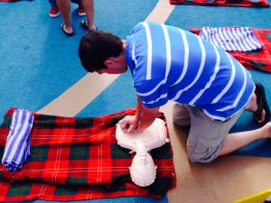 Editor, Mike Faust, practicing CPR aboard Ruby Princess