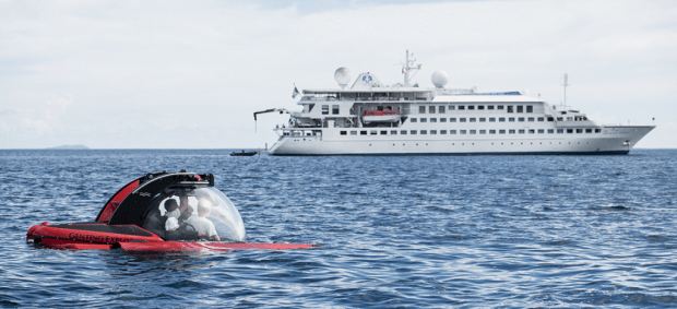 Crystal Esprit in the background with her private submersible in the foreground.