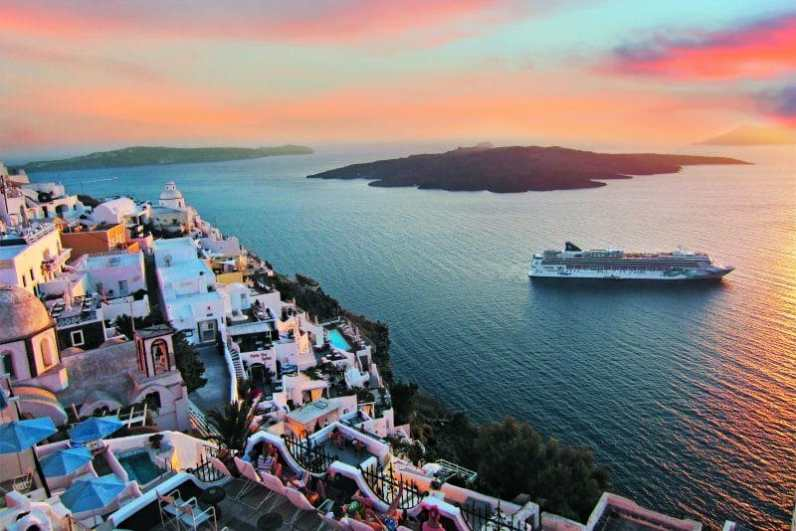 Norwegian Jade off the coast of Santorini Greece at sunset