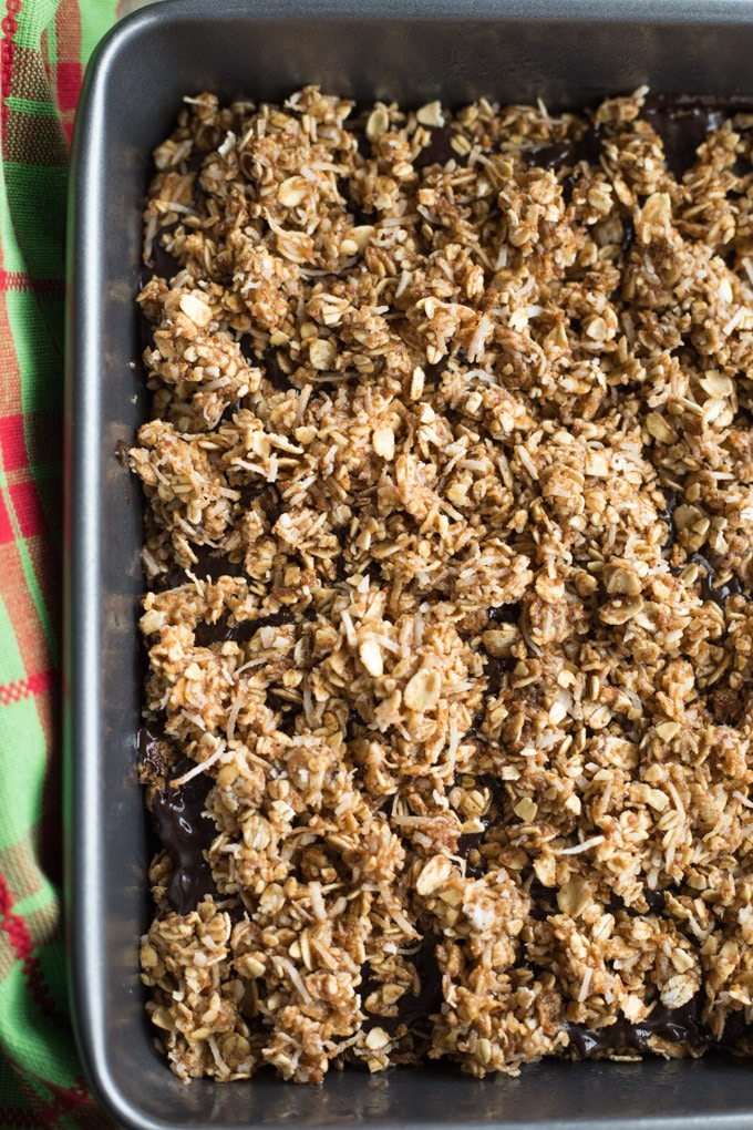 Up-close and overhead view of Chocolate Chai Spice Crumble Bars in a pan, ready to be baked.
