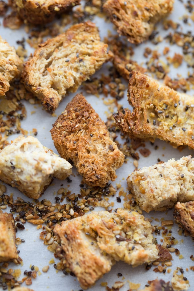 Up-close view of everything bagel seasoned croutons.