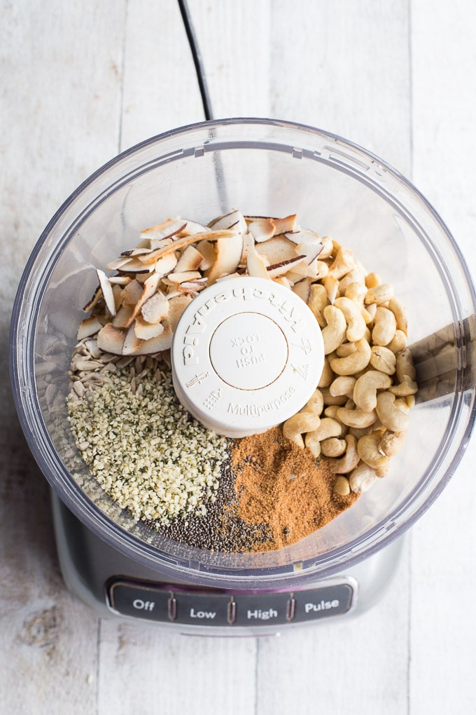Overhead view of ingredients for Coconut Cashew Crunch Grain-Free Granola in a food processor.