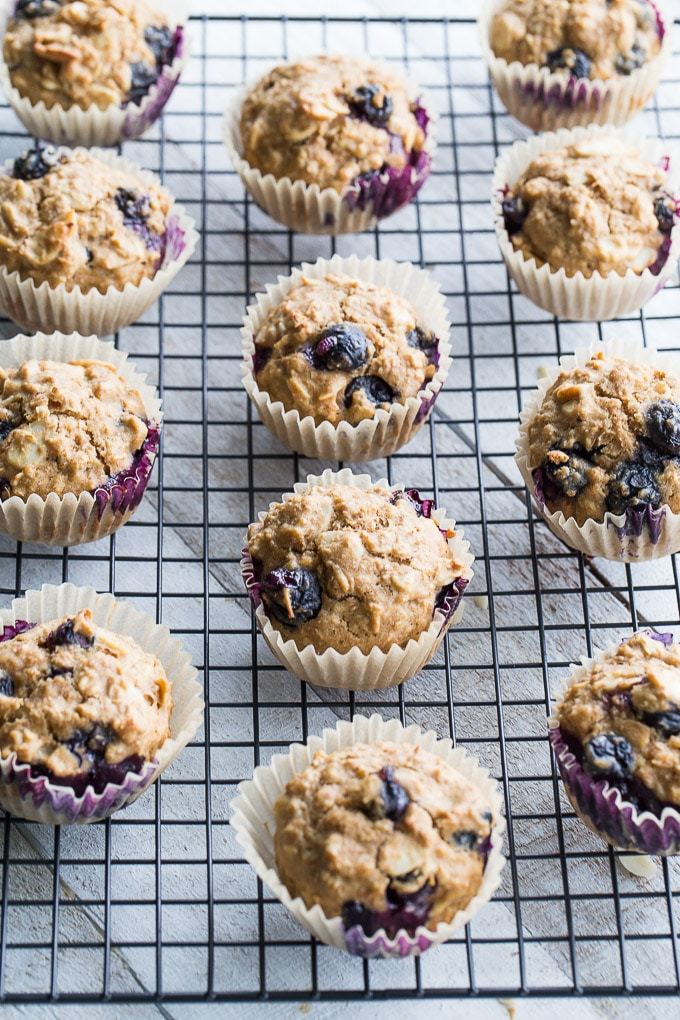 Overhead view of Blueberry Vanilla Almond Overnight Oatmeal Muffins cooling on a wire rack.