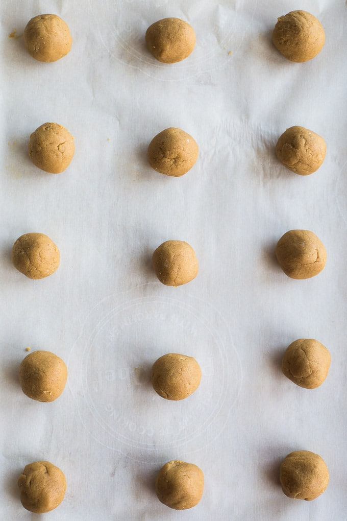 Overhead view of dough balls for Chewy Ginger Cookies arranged on a baking sheet.